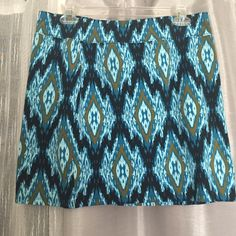 HP NWT Pieces by Kensie Ikat Print Skirt NWT Pieces by Kensie Ikat print mini skirt. Stretch material. Approximately 16 inches total length, 16 inches across at top. Material 95% cotton, 5% spandex Kensie Skirts Mini