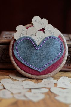 Embroidery Hoop Art. Handembroidered Felt Heart Pocket Filled with 10 Conversation Hearts for Valentine's Day by Catshy Crafts. $40.00, via Etsy.