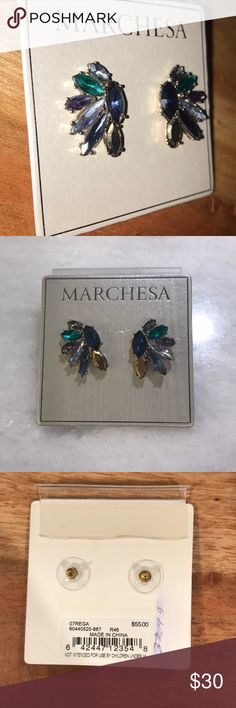 Marchesa cluster stud earrings Clusters of glittering marquise-cut crystals make a beautiful vintage inspired earring set. Post back. Silver tone plate. By Marchesa. Marchesa Accessories