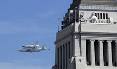 The #Endeavour flies near City Hall in downtown Los Angeles. Credit: Marc Martin / Los Angeles Times