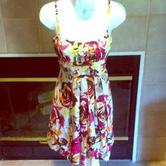 Gorgeous Floral Print Dress Floral print dress in EUC. Has some light padding in bust and spaghetti straps. Perfect for church, bridal showers, and sunday brunch! Super cute with sandals and a cardigan. Ties in back as shown! Fits ladies sizes 6. A. Byer Dresses Midi