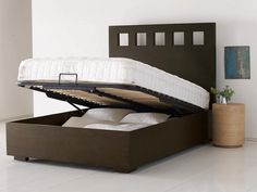 Pivot Bed Frame: Tuck pillows and blankets away. Check it out --> http://www.hgtv.com/bedrooms/chic-bedroom-storage/pictures/page-4.html?soc=pinterest