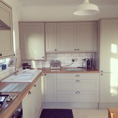 Howdens' light grey Greenwich kitchen units