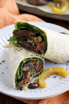 Vegan wraps stuffed with roasted slices of balsamic portobello mushrooms, veggies & quinoa is the perfect dinner for Meatless Mondays! Vegan + Dairy-free.