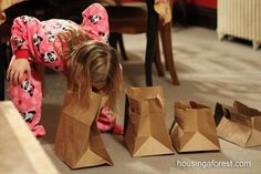 "Bite Me - The challenge was to pick up 5 paper bags cut at varying heights using only our mouths and place them on a table. Make sure that your knees or hands don't touch the floor! That is what makes this game so difficult. ""Minute to Win It"" Party Games, http://hative.com/minute-to-win-it-party-games/,"