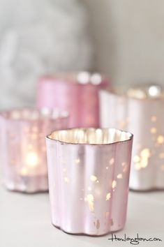 Pink tea light holder... DIY Idea... Paint the inside of your glass votive holder as desired with pink paint followed by Krylon's Looking Glass spray paint. *Distress as desired.