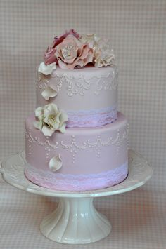a pretty soft pink two tier cake