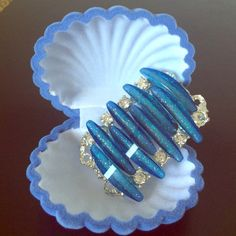 Blue Rhinestone Brooch A beautiful brooch/pin that will glam up any look. This is a very unique pin, I've never seen anything like it and it has a one of a kind shape.It would also go great with a dress or jeans to go to a party. Vintage Jewelry Brooches