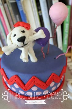 White puppy birthday cake. Puppy model and ballons . Pink, purple and red cake by Three Blind Moose Specialty cakes, Korumburra