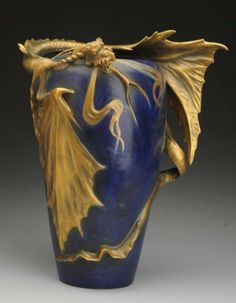 """Amphora Ceramic Dragon Vase. With blue and gold glazes. Amphora over mark on the underside. Slightly iridescent blue body. Minor restoration to the wing. Impressed number is """"4301"""". Condition (Mint). Size 14"""" T."""