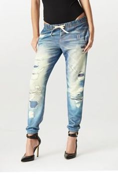 "Lounge Jean Fleece Pants | GUESS.com Sweats get a fashionable revamp with this pair of lounge pants. A photo-real destroyed denim print, cozy fleece fabric and drawstring make these ""jeans"" a must for every trendsetter. Knit pants. Relaxed fit and cinched hems. Photo-real destroyed denim print gives the illusion of a pair of distressed jeans, complete with pocket stitching and belt loops. Metal rivets. Two functional back pockets. Elasticized waist. Drawstring closure."
