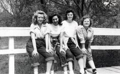 Early 1950′s teenagers on a weekend or summer break wearing Dungarees (blue jeans) with rolled up legs, colorful blouses, bobby socks and black and white saddle shoes