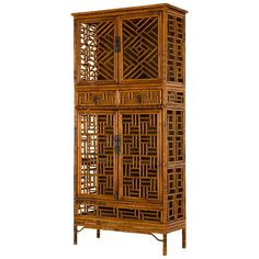 Vintage Fretwork Bamboo Cabinet | From a unique collection of antique and modern cabinets at https://www.1stdibs.com/furniture/storage-case-pieces/cabinets/
