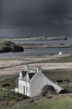 Isle of Skye, Scotland --- A cottage by the shore on an iso. Isle of Skye, Scotland --- A cottage by the shore on an isolated island off the coast of Scotla Places To Travel, Places To See, England And Scotland, Scotland Travel, Scotland Trip, Scotland Castles, Travel Inspiration, Colour Inspiration, Beautiful Places