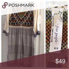 FREE PEOPLE knit dress BOHO FestivaL SZ S folk Never worn! FREE PEOPLE knit folk boho dress  in SZ S. Mix and match patterns in true FP style. Peasant bell sleeves, empire waist, a-line skirting. Beiges, greens, oranges, and black. A FREE PEOPLE must 💟 (JL20) Free People Dresses Mini