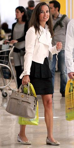 HIGH FLYER   She may be a lady-in-waiting, but that doesn't mean Pippa doesn't dress like the rest of us! Recycling her Modalu bag and her favorite pair of cream flats with her black-and-white ensemble, she looks perfectly pulled-together to catch a flight out of Madrid.