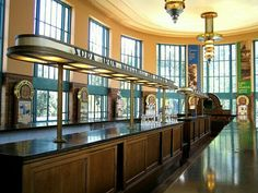 A side view of the Art Deco water bar at the Hall of Waters in Excelsior Springs, Missouri. At this end of the bar, you can see four of the five waters they served here: soda, iron, manganese and calcium