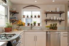 DIY. Stain wooden shelves with walnut stain, black shelf braces. incorporate long, horizontal chalkboard underneath.