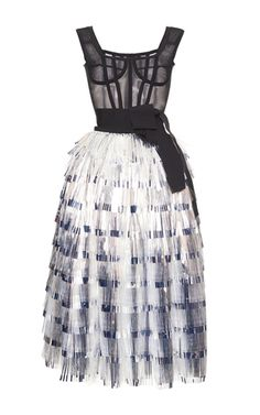 This **Dolce & Gabbana** dress features a constructed square neck, a tiered tinsel full skirt, and a grosgrain self belt at the waist.