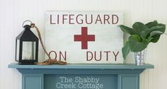 The Shabby Creek Cottage | Decorating | Craft Ideas | DIY: Summer Tour of Homes Day One. Great looking Lifeguard sign for Summer!