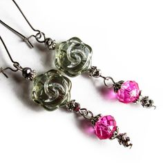 These beautiful green and hot pink glass earrings are made of rose shaped Czech vintage style glass bead, pink glass crystal and very small silver colored glass crystals. They also have silver colored nickel free kidney earring wires. Length of the dangling earring without the hook is about 52mm.