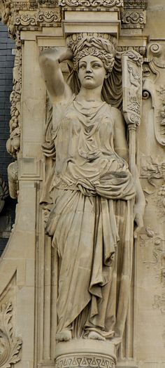 Caryatid at the Colbert Pavillion. Exterior of the Musee de Louvre.