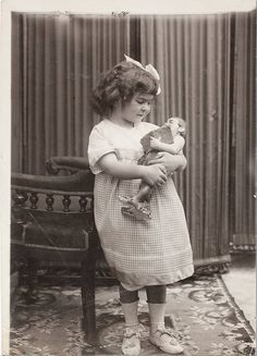 Little girl Frida Kahlo with her doll, 1913