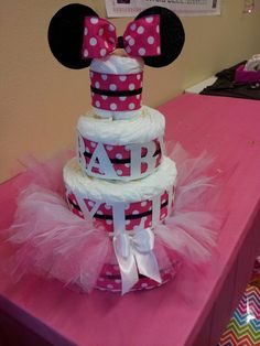 Minnie Mouse diaper cake that I made for my sisters baby shower(: Super simple, but cute. The tulle around the bottom layer is actually a tutu with a ribbon tie for adjustment.