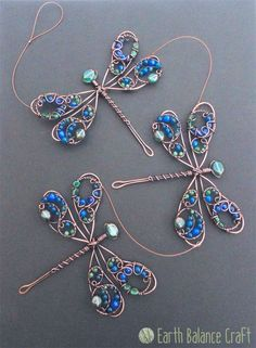 Triple Demoiselle Dragonfly Suncatcher - A decorative copper wire dragonfly hang. Triple Demoiselle Dragonfly Suncatcher - A decorative copper wire dragonfly hanging mobile featuring three of a rather special British species, the Beaded Dragonfly, Dragonfly Jewelry, Sea Glass Jewelry, Beaded Jewelry, Handmade Jewelry, Glass Beads, Copper Wire Art, Copper Wire Crafts, Copper Wire Jewelry