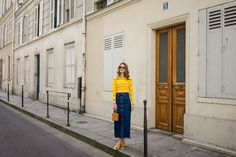Sunshine Yellow — Rue Rodier Www.ruerodier.com By Marissa Cox I'm wearing: Topshop Unique Top / Weekend Denim Skirt / Simon Miller Bag, / Garrett Leight Sunglasses, / Martiniano Pumps, / Missoma Pendant Necklace Paris Marais  Photography Blog  Walking around Paris France