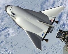 (Illustration) Dream Chaser Docking with the International Space Station -   An artist's concept of Sierra Nevada's Dream Chaser space plane docking with the International Space Station.