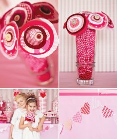 Fabric flowers in pink gum balls. Heart banners are also cute/simple decorations