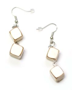 Two wood dangling squares in white with a painted gold trim make these handcrafted earrings unique, full of texture, fun, and lightweight.