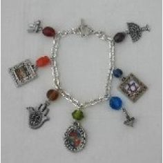 "This stylish, zesty fashionable accessory is the charm that you will never want to part with!  Silvertone 7"" charm bracelet is hand crafted by an American artist. Priced at $21.95 available at www.judaicaspecialties.com Fashion Accessories, Fashion Jewelry, Jewish Jewelry, Stainless Steel Necklace, Hamsa, American Artists, Charmed, Symbols, Stylish"