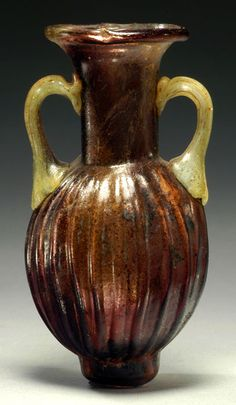Sidonian Mold Blown Amphora Century AD (Ancient Sidon, Now Medina Sidonia Spain) A major breakthrough in glass making was the discovery of glass blowing some time between 27 BC and 14 AD by Syrian craftsmen from Sidon Babylon.