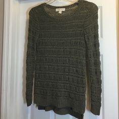 MICHAEL KORS SWEATER WITH SIDE ZIPPERS Open work Michael Kors sweater with gold zippers on each side!  The color is an army green/grey and has a hint of gold lamé intertwined.  This sweater, in EUC, is just a tad longer in the back. Very stylish! Michael Kors Sweaters Crew & Scoop Necks
