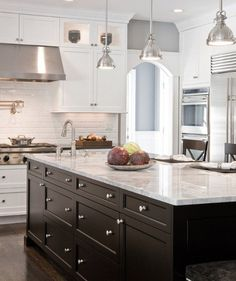 Super White granite countertop ideas large kitchen island modern pendant lamps dark kitchen island More