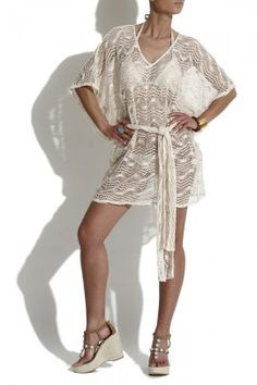 Perfect for hot summer days by the pool or at the beach - the beige tunic by Alexis in crochet design – a trendy it-piece of the season $225