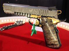 Damascus steel 1911 with mammoth tooth grips