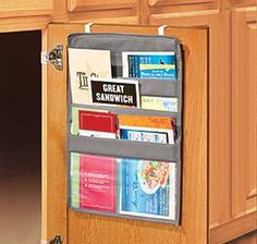 Menu Organizer - inside the cabinet, takes up no space. Could also be used in the office or craft room for guides, manuals, etc...