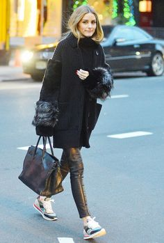 Olivia Palermo looking chic in a fur sleeve coat, Hermes bag and Etro Sneakers