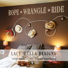 "www.lacybella.com ""Rope Wrangle Ride"" vinyl lettering cowboy western wall decal. Cowboy themed boys bedroom with ropes and cowboy hats on the wall with the rustic style font and sheriff star embellishments."