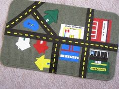 Mat Roadway DIY Kitchen Mat Roadway - perfect for Hot wheel cars!DIY Kitchen Mat Roadway - perfect for Hot wheel cars! Preschool At Home, Preschool Activities, Creative Activities, Map Projects, Projects To Try, School Projects, Transportation Unit, Community Activities, Community Helpers