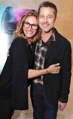 Julia Roberts hugs it out with Brad Pitt while donning stunning square maroon specs with temple accents.