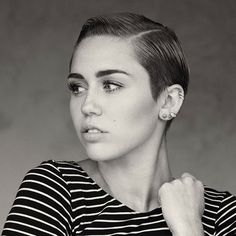 She kind of looks like Stewart from Mad TV. Miley Cyrus very short hair
