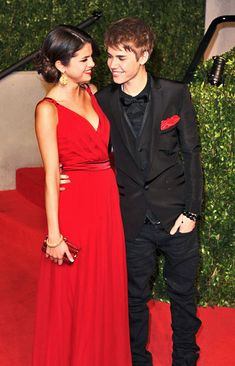 I LOVE her dress!! and I think it's so cute how he put the red in his outfit to match her dress. Great call Bieber