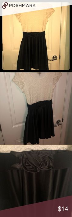 9af1c2ff023a Fun a flirty party dress Fit and flare black and white dress with belt. Rose