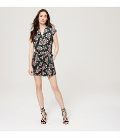 """Strewn in exotic florals, this clean cut romper is intrinsically chic - and ultra flattering. Crossover V-neck. Cap sleeves. Fold-over wrap front with hook and bar closure at waist. Pleats at and beneath waist. Front slash pockets. Back welt pockets. Partially lined. 3 1/4"""" inseam."""