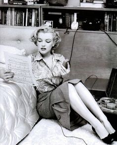 Marilyn photographed in her Hollywood apartment studying sheet music for a song she never recorded, 1951.
