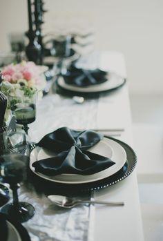Black napkins folded to look like bow ties